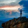 mountain-sunset-man-arms-open